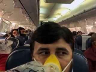 Паника на борту пассажирского самолета (ВИДЕО)