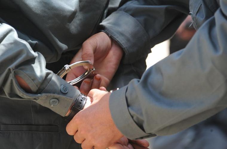 Grupare criminală încătușată de polițiști (VIDEO)