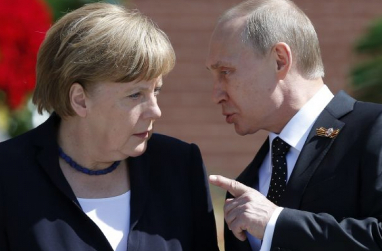 Merkel a vorbit cu Putin despre întoarcerea observatorilor ruşi în Ucraina