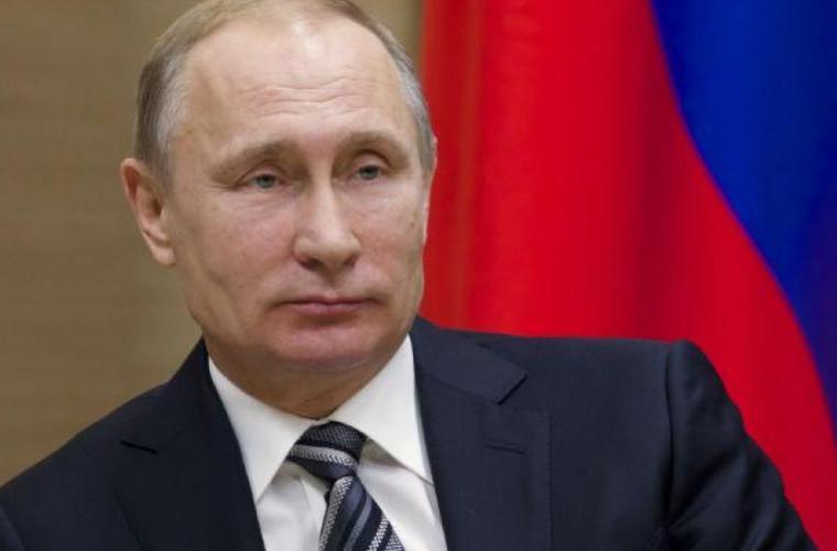 Putin şi-a anunţat oficial candidatura la alegerile prezidenţiale din Rusia