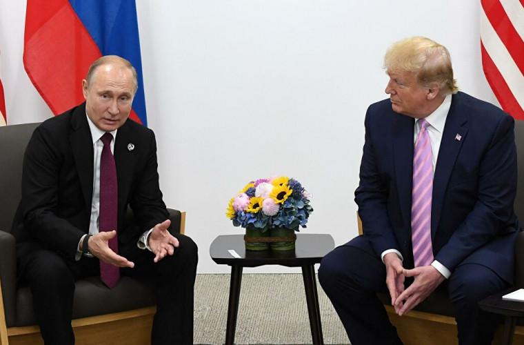 """Trump a numit negocierile cu Putin """"foarte productive"""""""