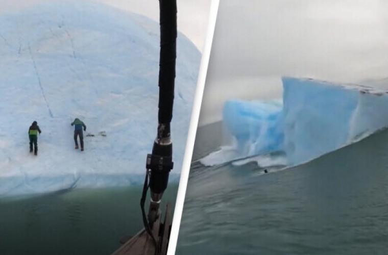 Un aisberg s-a răsturnat în mare cu doi exploratori care încercau să îl escaladeze